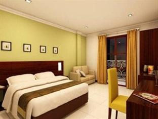 green kayon resort and spa solo deluxe room, double bed
